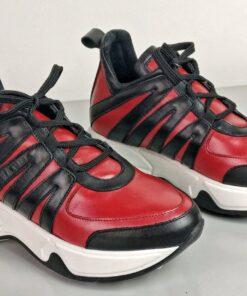 Sneakers in pelle rossa con inserti vitello nero