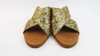 Ciabatte incrociate in pelle con glitter oro