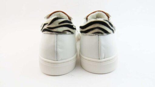 Sneakerscolore bianco allacciate con stella oro e talloncino zebrato