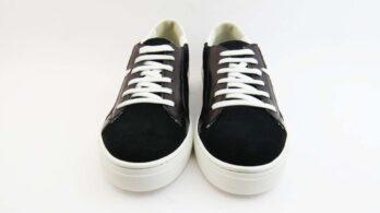 Sneakerscolore nero allacciate con stella bianco e tomaia tech