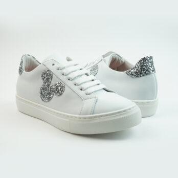 Sneakersbasse in pelle colore bianco con topoface e talloncino colore glitter argento