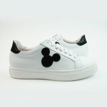Sneakersbasse in pelle colore bianco con topoface e talloncino colore nero