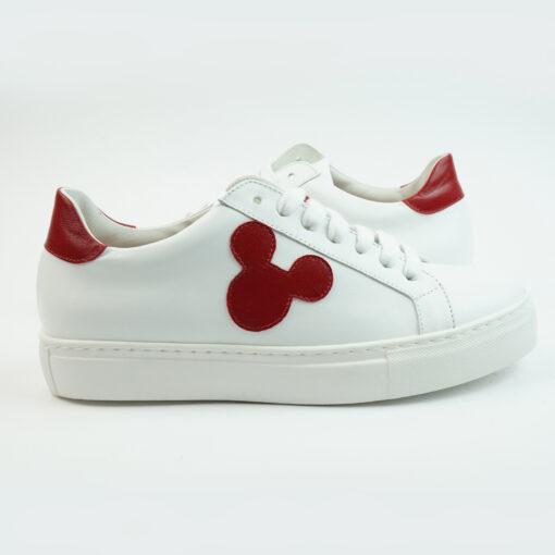 Sneakersbasse in pelle colore bianco con topoface e talloncino colore rosso